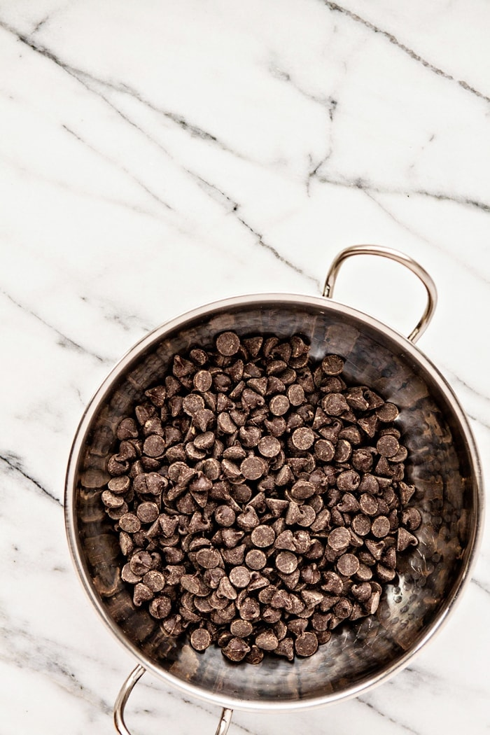 Learning how to temper chocolate properly is essential when you want to make homemade candies, such as truffles or chocolate bark. Follow this how-to for all you need to know about chocolate tempering.