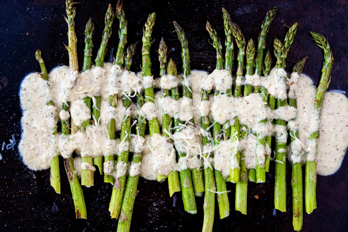 oven roasted asparagus drizzled with lemon dressing