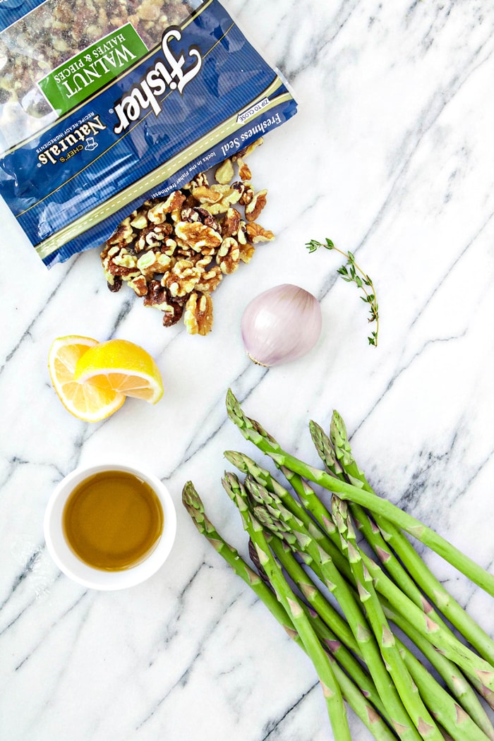 ingredients for oven roasted asparagus on marble countertop