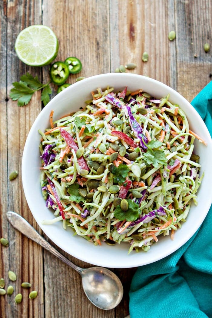 This Cilantro Lime Broccoli Slaw is  a tasty side dish to accompany any Mexican inspired meal.  Pre-packaged shredded broccoli, carrots, red cabbage are tossed with jalapeño, lime, red onion, and red bell pepper for a refreshing side salad.