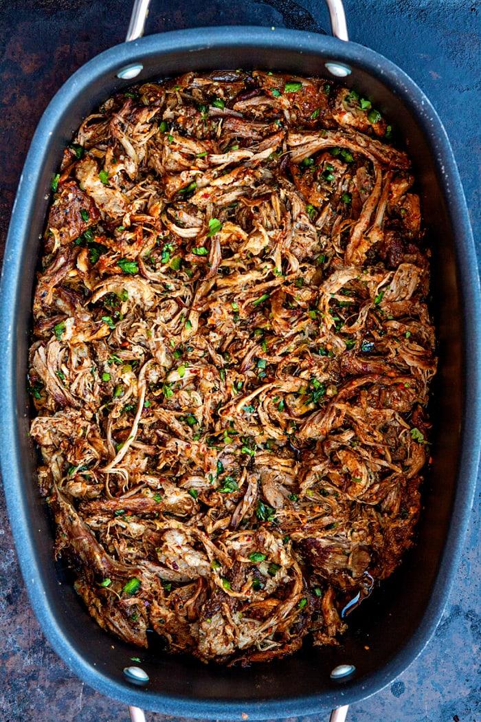 easy crockpot pulled pork in large serving dish