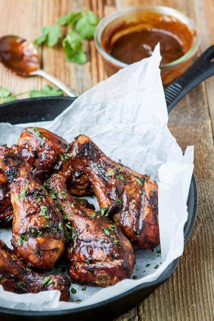 Chicken drumsticks are basted with Mango Habanero BBQ sauce for a delicious addition to any summer potluck.