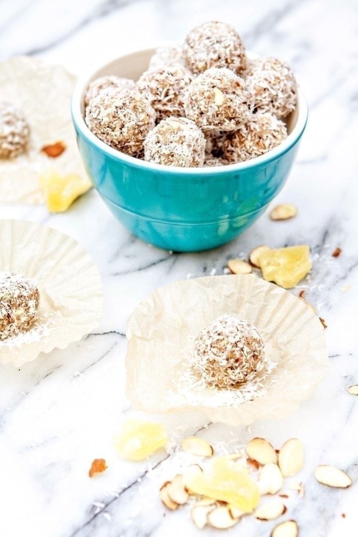 Pina Colada Energy Balls | Pina Colada Energy Balls feature a mix of protein, healthy fats, and naturally sweet pineapple, dates and coconut. Pop these bite-sized treats in your mouth for a quick snack and energy fix.