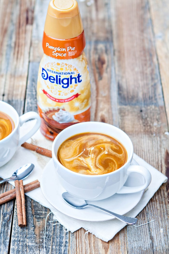 pumpkin chai latte in front of bottle of International Delight creamer