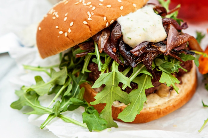 Gouda Stuffed Burgers with Horseradish Aioli and Caramelized Onions