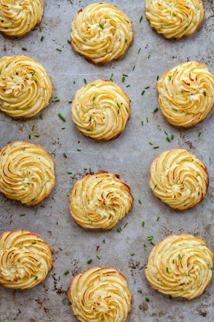 Cream Cheese Chive Duchess Potatoes are delicious, individually portioned mounds of mashed potatoes that have been baked. Inside they're creamy and fluffy while the outside is beautifully golden and crisp.