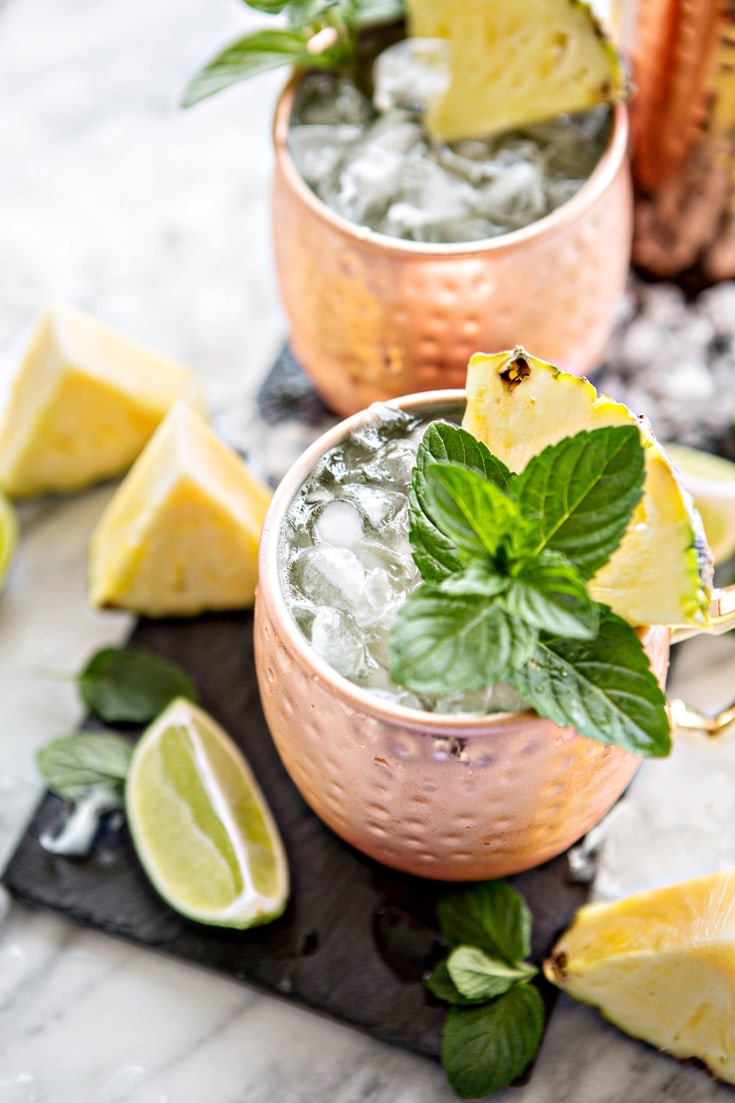 A classic Moscow Mule get a fruity twist with this recipe for Fresh Pineapple Mint Moscow Mules.