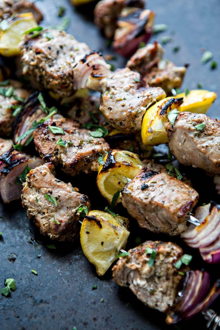 Fresh summer meals and outdoor entertaining are where it is at when it comes to this Greek Pork Kebab Platter with Greek Pico de Gallo. Juicy chunks of pork tenderloin are grilled with onion, lemon, and oregano and served platter style with Greek Pico de Gallo.