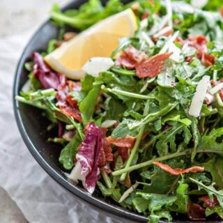 kale is tossed with a simple lemon dijon vinaigrette and topped with ...