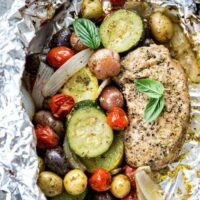 Pesto Pork Chop and Summer Vegetable Foil Dinners