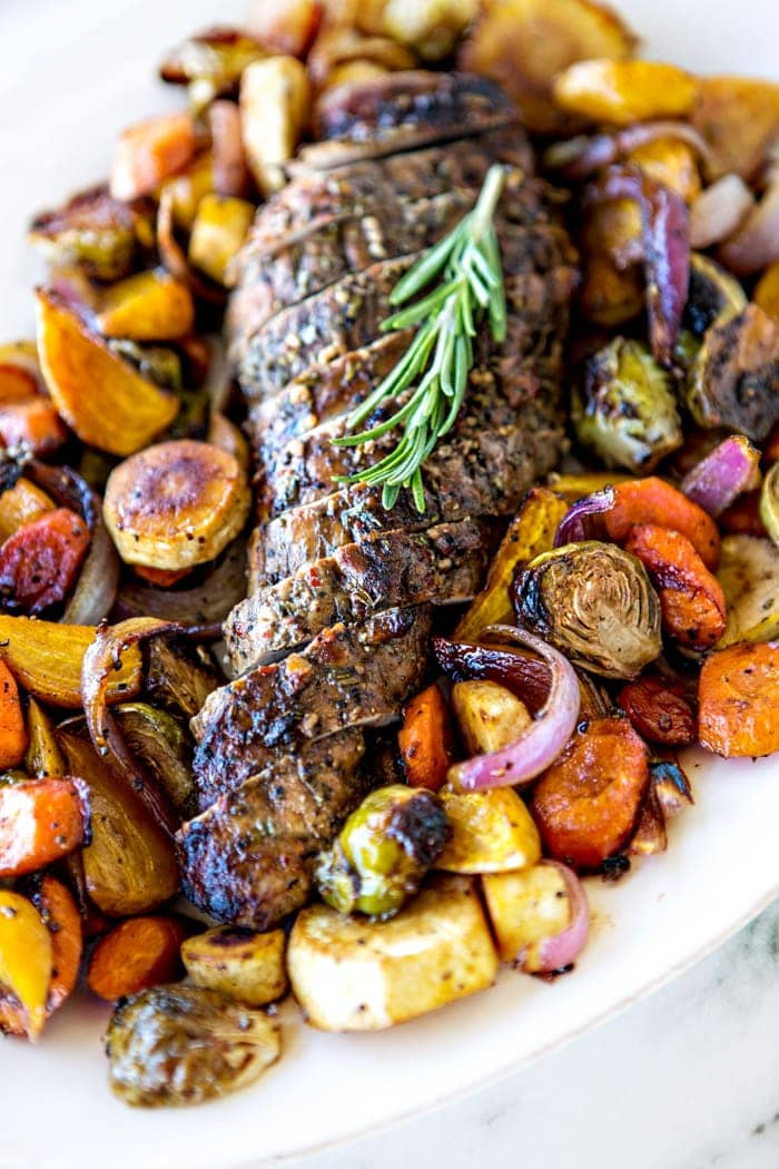 Dinner just got super quick and easy thanks to this sheet pan meal featuring roasted pork, carrots, golden beets, red onion, Brussels Sprouts, and parsnips.