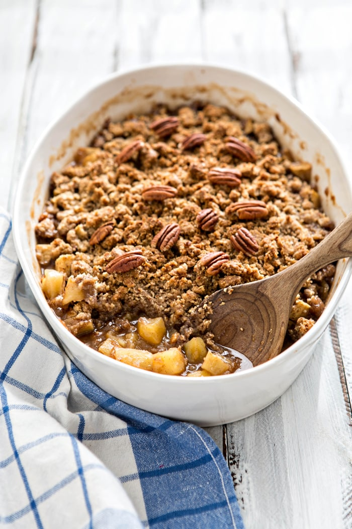 Apple Crisp with Oatmeal Crumble Topping in a white baking dish