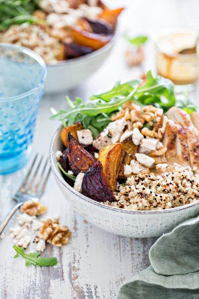 Fuel up and support heart health with this Chicken, Beet, and Arugula Quinoa Bowl with Walnut Sherry Molasses Vinaigrette.   This recipe features lots of delicious produce, hearty quinoa, protein rich chicken, salty goat cheese, and nutty heart-healthy walnuts for a filling, satisfying meal.