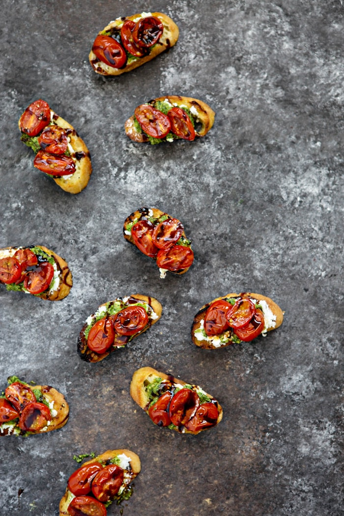Roasted Tomato Crostini with Walnut Almond Pesto and Goat Cheese appetizer for summer photo and recipe