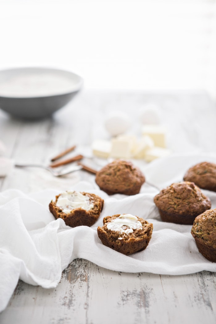 Zucchini Apple Spice Muffins are perfect for the transition space between summer and fall – you can use up the loads of summer zucchini that are laying around in your garden, the grocery store, or at the farmer's marker, while savoring the fall spice flavors and a hint of apple.