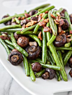 Garlic Bacon Sautéed Green Beans with Roasted Mushrooms make a great Thanksgiving side dish, loaded with flavor, and a lot more fresh tasting than the traditional green bean casserole.