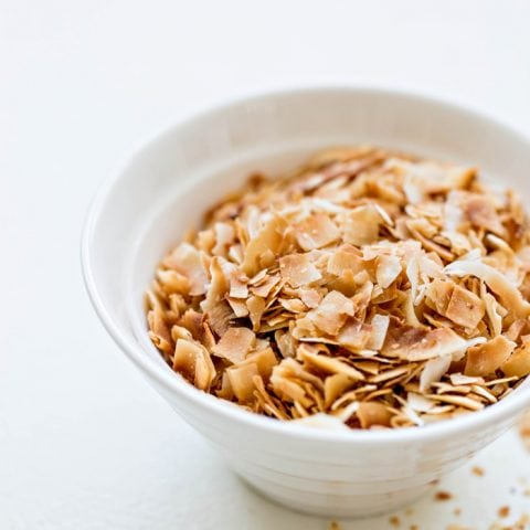 toasted coconut in a white bowl