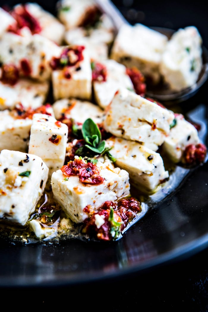 close up shot of feta with chopped sun dried tomatoes