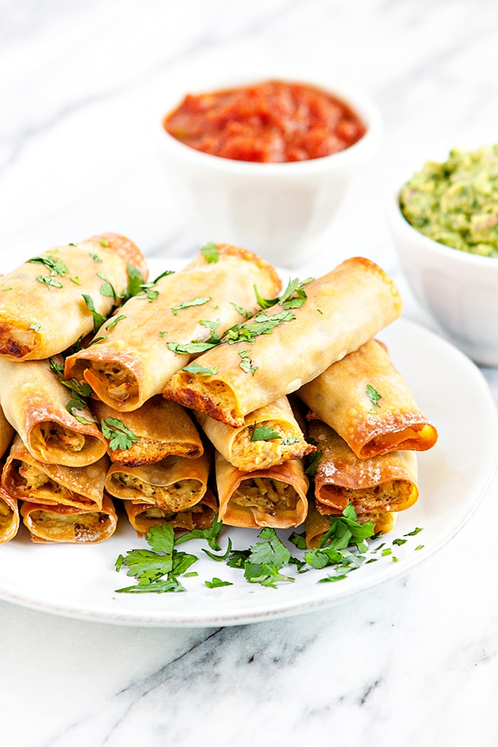 baked chicken taquitos on a white plate