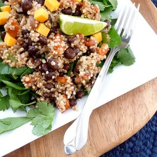 quinoa with black beans on a white plate