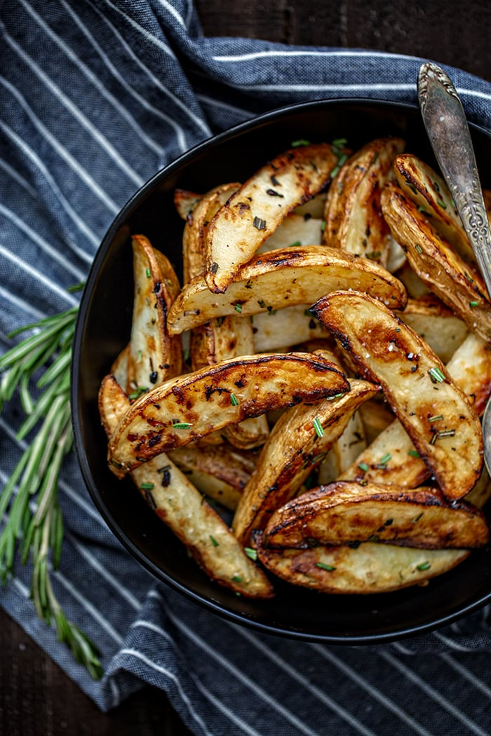 bowl with roasted potatoes and rosemary