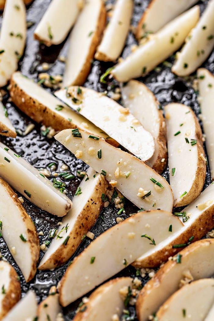 potato wedges on baking sheet