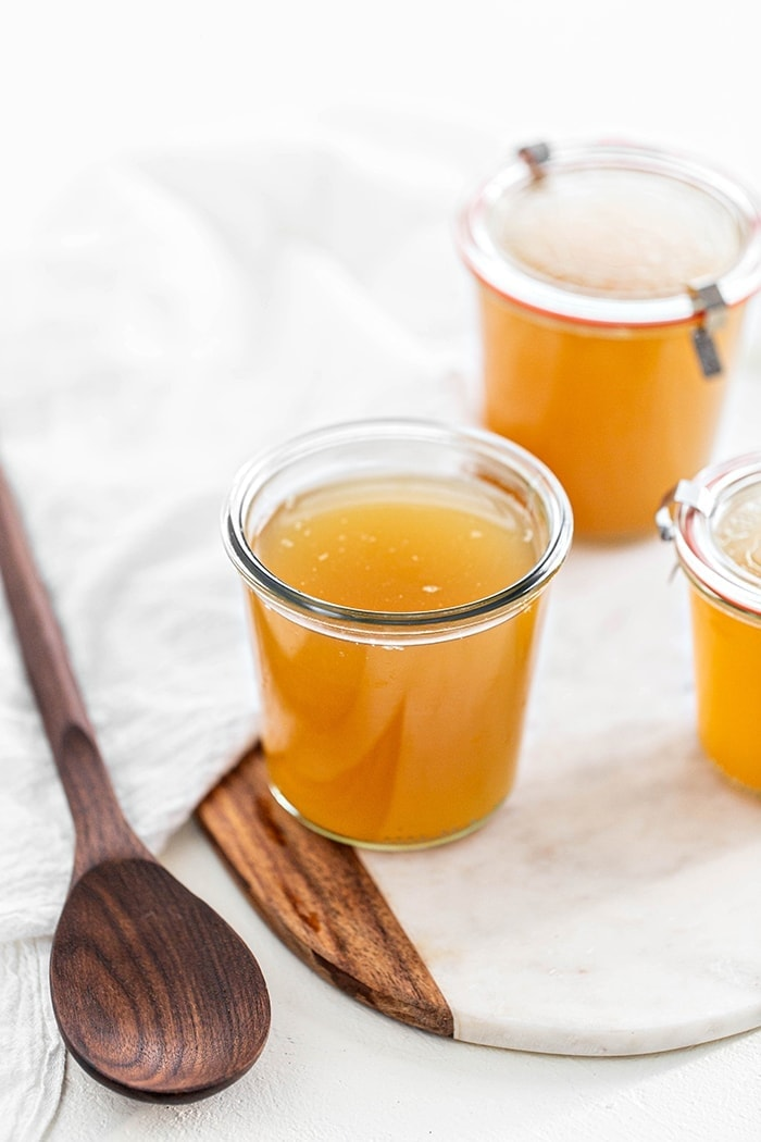 jars of turkey stock on a white background