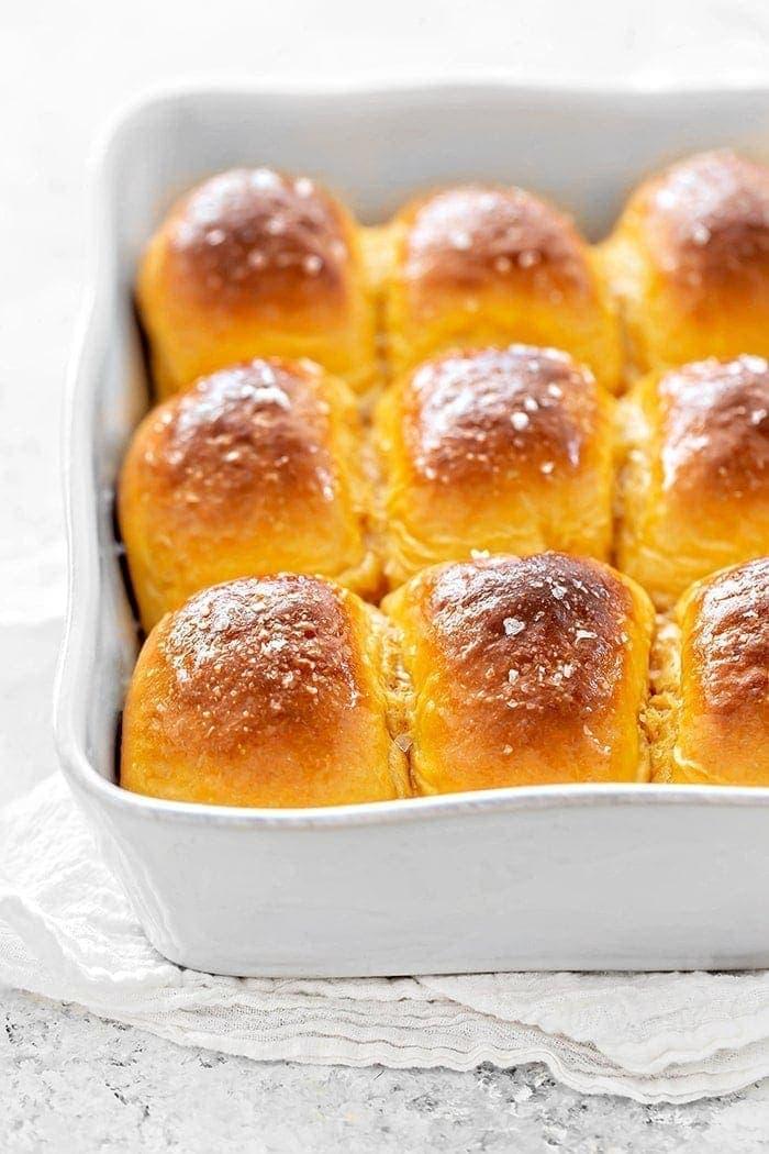sweet potato dinner rolls in a white baking dish