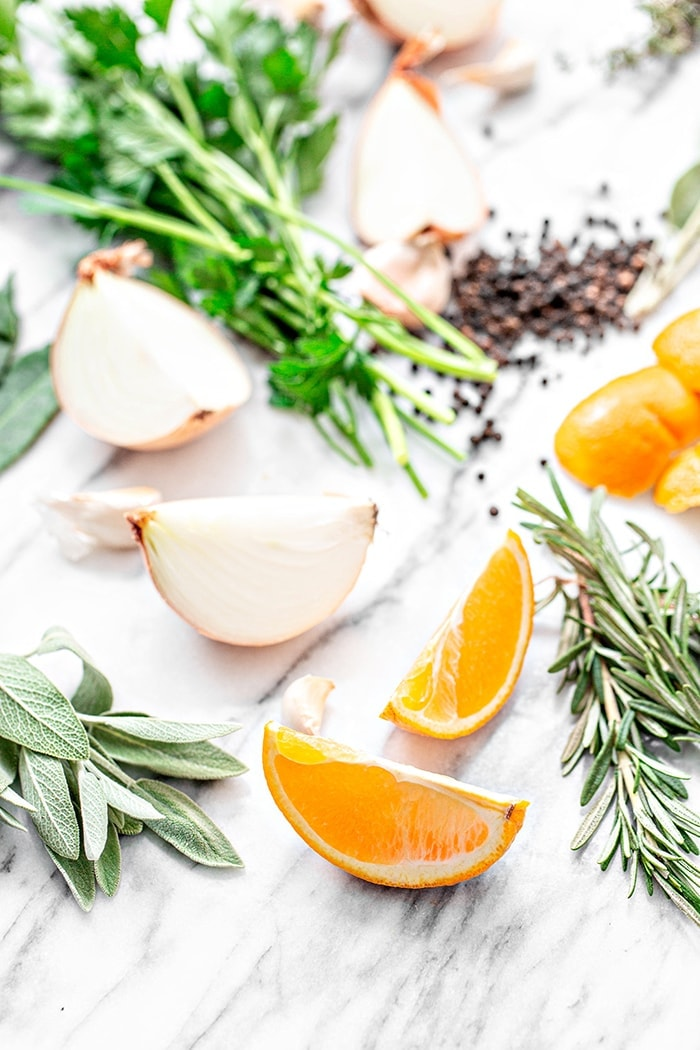 orange slices and fresh herbs on white background