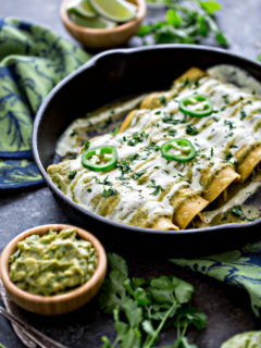 salsa verde enchiladas in a cast iron pan