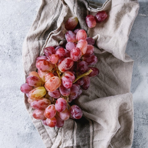 washed red grapes on a towel