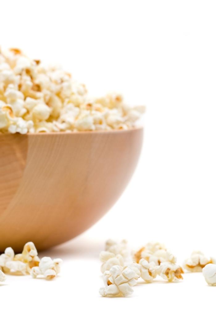 bowl of popcorn on white background