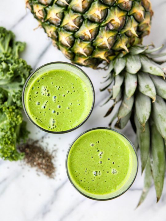 Green smoothie in a glass with kale and pineapple