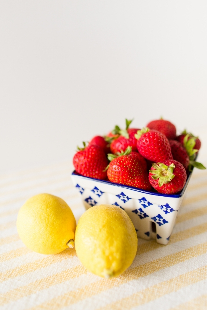 strawberries and lemons on a counter