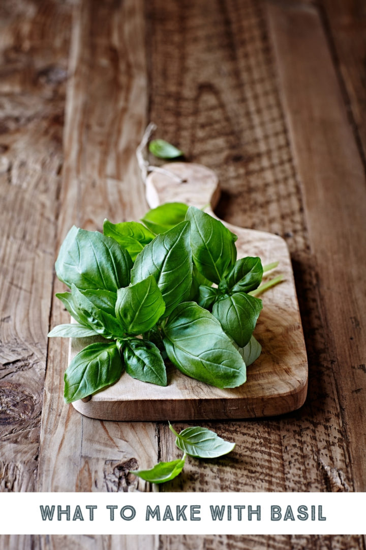 fresh basil on a wooden cutting board on a table