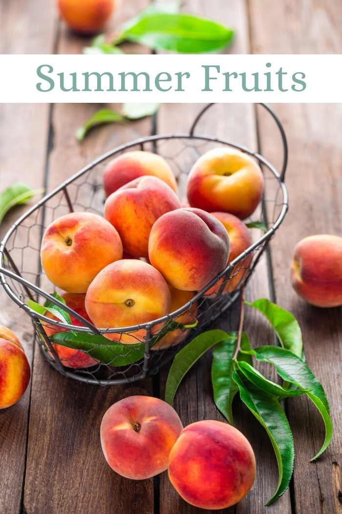 freshly picked peaches in a basket on a wooden table