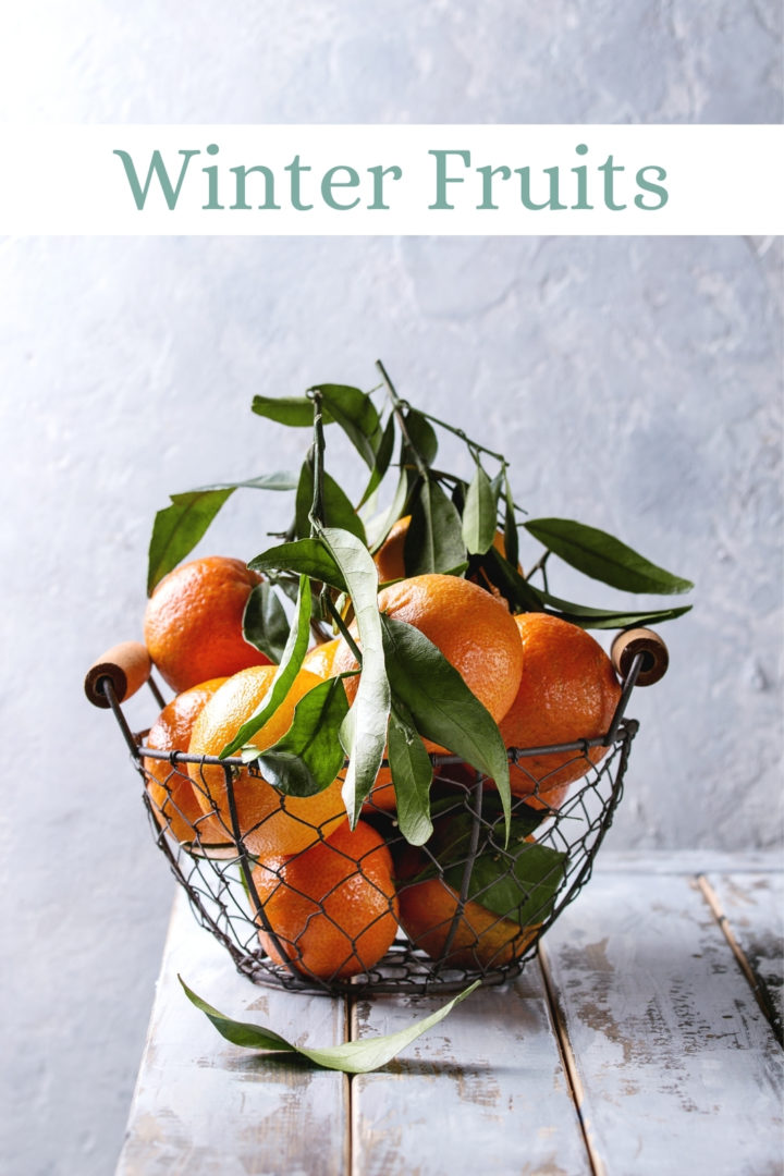 photo of clementines in a wire basket on a farmhouse table